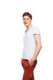 Junger blonder Mann lokalisiert auf Weiß Lizenzfreies Stockfoto