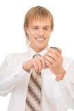 Junger blonder Mann mit Handy Stockfotos