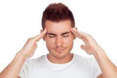 Junger blonder Mann mit Kopfschmerzen Stockfotografie