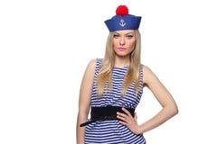 Junger blonder weiblicher Seemann, der in ihrer Uniform aufwirft Lizenzfreie Stockbilder