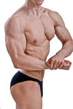 Junger Bodybuilder, der Muskeln biegt Lizenzfreies Stockbild