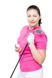 Junger Brunette liebt, das Golf zu spielen und wirft auf einem Weiß auf Lizenzfreies Stockbild