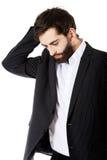 Junger deprimierter Geschäftsmann Lizenzfreies Stockbild