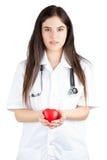 Junger Doktor Gently Holds ein Herz Lizenzfreie Stockfotografie
