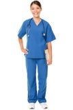 Junger Doktor im Blau scheuert sich stockfoto