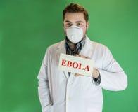 Junger Doktor mit Ebola-Zeichen Stockfoto