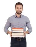 Junger Erwachsener mit Büchern stockfotografie