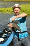 Junger Fischer mit einem Fisch Stockfotos
