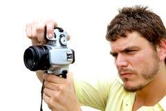 Junger Fotograf mit Kamera Stockbild