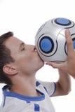 Junger Fußballspieler in der Tätigkeit Lizenzfreie Stockfotos