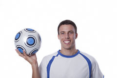 Junger Fußballspieler in der Tätigkeit Lizenzfreie Stockbilder