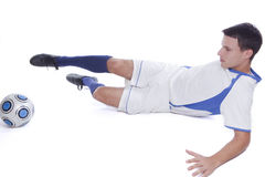 Junger Fußballspieler in der Tätigkeit Lizenzfreie Stockfotografie