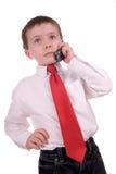 Junger Geschäftsjunge auf Zelle Stockbild