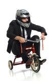 Junger Geschäftsmann auf Dreirad lizenzfreie stockbilder