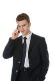 Junger Geschäftsmann, der über dem Telefon benennt Stockfotografie