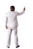 Junger Geschäftsmann, der auf Kopienraum zeigt. hintere Ansicht. lizenzfreies stockfoto