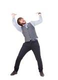 Junger Geschäftsmann, der etwas hochdrückt Lizenzfreies Stockbild