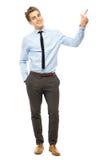 Junger Geschäftsmann, der oben zeigt Lizenzfreies Stockfoto