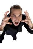 Junger Geschäftsmann, der Oberseite schreit und schaut Stockfotos