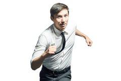 Junger Geschäftsmann, der schnell läuft Lizenzfreie Stockfotos