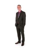 Junger Geschäftsmann in einer Klage mit einem großen Lächeln Lizenzfreies Stockfoto
