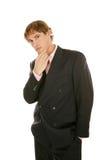 Junger Geschäftsmann - es vorbei denkend Stockbild
