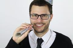 Junger Geschäftsmann feiern das neue Jahr Lizenzfreies Stockfoto