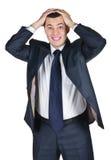 Junger Geschäftsmann gesorgt mit einem falschen Geschäft Lizenzfreie Stockfotografie