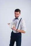 Junger Geschäftsmann hält einen Fan von Dollar Stockfoto
