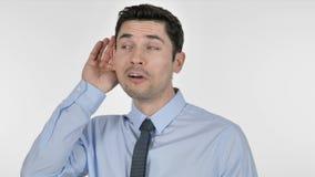 Junger Geschäftsmann Listening Secret, weißer Hintergrund stock footage
