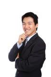 Junger Geschäftsmann mit überzeugtem Lächeln stockfoto