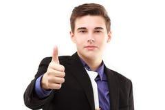 Junger Geschäftsmann mit dem Daumen oben Lizenzfreies Stockfoto