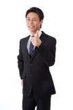 Junger Geschäftsmann mit einem Wink und den Daumen oben Stockfotos