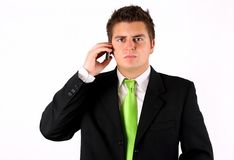 Junger Geschäftsmann mit Telefon stockbild