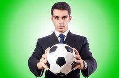 Junger Geschäftsmann mit Fußball auf Weiß Lizenzfreies Stockfoto