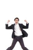 Junger glücklicher Geschäftsmann, der in die Luft, lokalisiert auf Weiß springt Lizenzfreie Stockfotografie