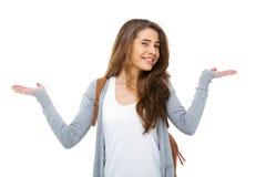 Junger glücklicher Student, der im Zweifel - lokalisiert zuckt lizenzfreies stockfoto