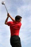 Junger Golfspieler mit Treiber Stockfotos
