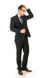 Junger, hübscher Geschäftsmann, der schwarzen Anzug trägt Stockfotos