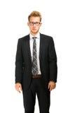 Junger, hübscher Geschäftsmann, der schwarzen Anzug trägt Stockbilder