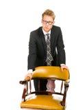 Junger, hübscher Geschäftsmann, der schwarzen Anzug trägt Stockfoto