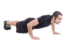 Junger hübscher bärtiger arabischer Mann, beim Sportkleidungshandeln drücken ist oben Stockfotos