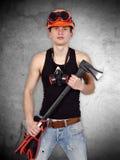 Junger Heimwerker mit Axt Lizenzfreie Stockfotos