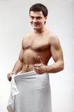 Junger hemdloser muskulöser Mann Stockfoto