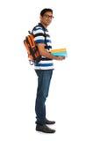 Junger indischer Collegemann mit lokalisiertem weißem Hintergrund Stockfoto