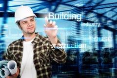 Junger Ingenieur, Architekt, Geschäftsmann, der auf Gebäude zeigen und Baukonzept Stockbilder