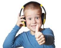 Junger Junge in den Kopfhörern Lizenzfreie Stockbilder