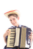 Junger Junge, der eine accordian Vertikale spielt Lizenzfreies Stockbild