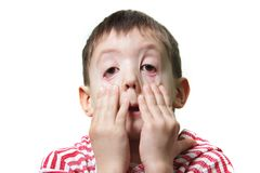 Junger Junge, der Gesichter bildet Lizenzfreies Stockbild