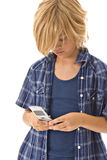 Junger Junge, der Mobiltelefon verwendet Lizenzfreie Stockbilder